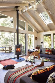 When a Portland couple renovated this a-frame house outside of Portland, they added windows everywhere to energize the traditionally dark architectural style