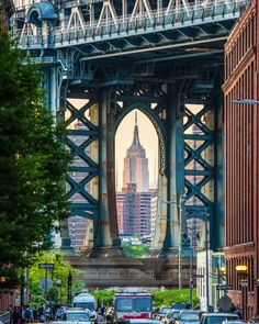 The Empire State Building framed by the eastern tower of the Manhattan Bridge. You can get this shot on the corner of Washington and Water streets in DUMBO, Brooklyn, NYC. #SeeYourCity, then share your city!
