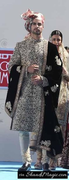 Black Velvet Stole Velvet clothes give you a heavy Indian royal look like this in the image. Though, wedding sherwani is a black and white with little golden embroidery designs can surely work for your engagement.
