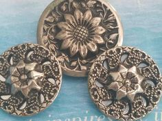 Check out this item in my Etsy shop https://www.etsy.com/listing/570849048/vintage-buttons-assorted-antique-silver