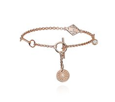 """Gambade Hermes bracelet in rose gold set with 2 diamonds (.11 ct), size extra small Circumference: 6"""""""