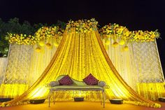Vibrant yellow stage backdrop | The Maharani Diaries More