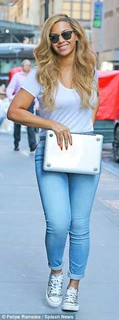 All in the jeans: The Single Ladies hit maker was more dressed down on Sunday as she took a walk with her laptop