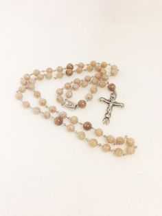 A rosary made from your wedding bouquet!! I so wish I had done this for my wedding. Would make a great wedding gift!