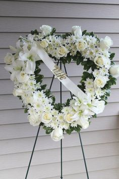All white sympathy open heart arrangement.