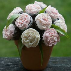 """Cupcake """"Bouquet""""    A tasty bouquet encourages guests to do more than stop and smell the roses. Frosted with strawberry icing and placed in a planting pot, the chocolate cupcakes in this edible centerpiece are ripe for the picking. Cupcake bouquet"""