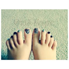 "nails done by me. ( Glitter Zebra ) POLISHES USED: • Revlon ""Colorstay Gel Envy""/Blackjack • Sally Hansen ""hard nails"" Xteme Wear/ White On •Salon Perfect Black Striper GLITTER POLISHES: • base: Maybelline NewYork ""Color Show"": Silver Stunner • Pure Ice/ Dazzle Me"