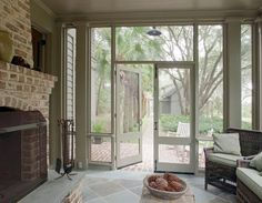 Spring Island Cottage - Screened porch with fireplace