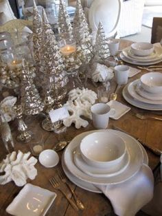 Mercury glass trees, hurricane  candle holders, silver raindeer on rustic table and white dishes.   Once In a Little While...: 12/01/2011 - 01/01/2012