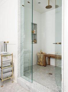 We especially love that bronzed shower head! | Photographer:  Alex Lukey  Designer:  Mazen El-Abdallah