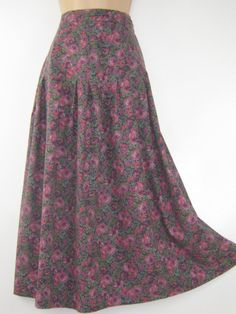 L A U R A A S H L E Y  I dont like ephemeral things, I like things that last forever  TRADITIONAL ENGLISH COUNTRY STYLE WEAR FROM THE 80s -YET FOREVER TIMELESS  THIS PRISTINE AUTUMN / WINTER SKIRT IN A SOFT COTTON / WOOL BLEND FABRIC MAKES FOR CLASSIC DAY WEAR DURING THE COLDER SEASONS. WEAR WITH FLATS OR BOOTS, THIS SKIRT COMBINES BEAUTIFULLY WITH KNIT TOPS OR BLOUSES AND ALWAYS LOOKS ROMANTICALLY STYLISH. FITTING SNUG AROUND WAIST , THE CLOSED PLEATS OPEN UP 7 BENEATH WAISTBAND AND GIVE…