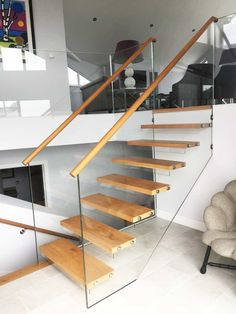 Timber & Glass Stairs are bespoke made by Camel from our Joinery In Wadebridge Cornwall we also offer a full design and installation service Stairs Window, Glass Stairs, Concrete Stairs, Timber Stair, Water Architecture, Modern Stairs, Glass Photo, Log Cabin Homes, Joinery