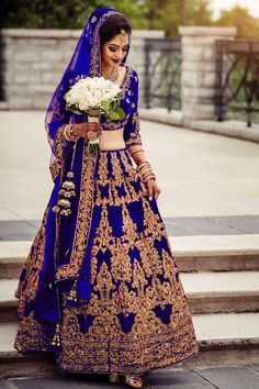 Wearing a blue bridal lehenga for your big day? These blue bridal lehengas will up your glamour quotient. The unique lehenga is in huge demand nowadays. Take cues from these designer lehenga. Indian Bridal Outfits, Indian Bridal Lehenga, Indian Dresses, Bridal Dresses, Indian Clothes, Pakistani Dresses, Saris, Asian Wedding Dress, Blue Lehenga
