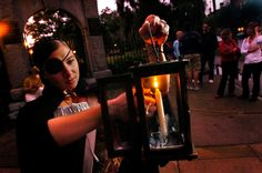 Cobblestone Tours guide lights her lantern in front of the Colonial Park Cemetery before starting her ghost tour in Savannah, Ga. Few cities in the country have the history and folklore of Savannah, Ga., (Photo/Stephen Morton)