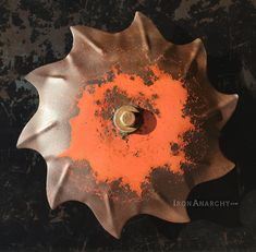 Large convex disk of thick steel in a dynamic spiked design with an aged patina of worn red paint and oxidation. Custom wall bracket projects disk 1 from wall. Industrial Farmhouse Decor, Industrial House, Industrial Chic, Vintage Industrial, Steampunk Home Decor, Steampunk House, Red Paint, Custom Wall, Wall Art Decor