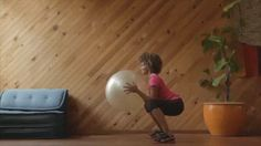 Swiss Ball Squat, 3 sets of 15 reps, Kelly Ann Charles Good for glute, thigh and arm strengthening and toning.