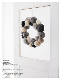 "What if I did a white yarn ""puff"" wreath... with a flower corsage and ribbons on the side?"