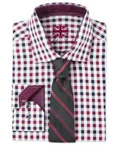 Tucked in with buttoned cuffs by day for a professional look, untucked and with rolled contrasting cuffs at night for a sharp, modern European look, this handsome check dress shirt from Michelsons acc