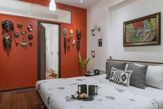 Colorful vibrant orange wall in bedroom - Ar. Puran Kumar