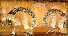 Golden rings Pakistani Wedding Theme decoration stage setup. Theme design and…