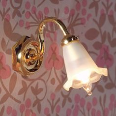 Shed some light on the matter with this tulip wall light. 25 x 10mm