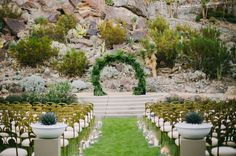 Tropical altar. Such a perfect Palm Springs ceremony site; with a tropical arch by Sticks and Stones Floral Design acting as the best of backdrops.