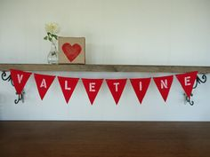 Decorate for your #Valentine's Day party with the felt Valentine Banner. This Bunting adds a splash of color to any room. #decorate By SweetThymes