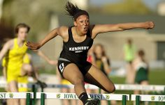 Cedar Rapids Kennedy's Marisa Estelle clears a hurdle on her way to setting a meet record in the 100-meter hurdles during the Mississippi Valley Conference Mississippi Divisional track meet at Iowa City West High School on Monday, May 6, 2013, in Iowa City, Iowa. (Jim Slosiarek/The Gazette-KCRG)