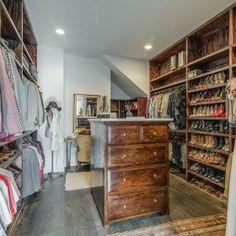 amazing-rustic-walk-in-closet-tall-closet-island-concrete-top-cowhide-vanity-chair