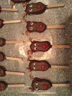 Reindeer Pops.....I made these for my son's pre-school Christmas party this past year.   Made with Nutter Butter cookies dipped in chocolate. Pretzel antlers, M&M nose and frosting for the eyes. If you want to add the stick, do so before dipping in chocolate.