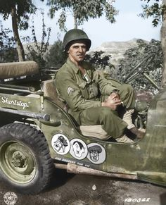 US Army Corporal Paul F. Janesk posing in his jeep in Sicily, 3 Sep note cartoon of Axis leaders drawn on his jeep, and Mussolini crossed out (US Army Signal Corps photo) Willys Mb, Military Jeep, Military Vehicles, Military Issue, Military Uniforms, Military Art, Old Jeep, Jeep Jeep, Wrangler Jeep