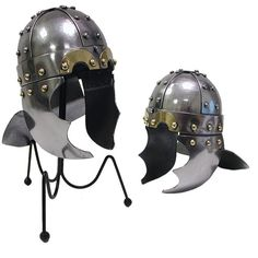 """From our medieval miniatures collection, this fantastic�helmet is inspired from viking tradition, with golden brow eye cut-outs and two """"mandibular"""" cheek armor plates.�    The helm has several decorative golden studs. The helmet flares out in the rear to increase mobility while still providing protection for the neck.� This exceptional� helm is skillfully crafted of carbon steel�and adorned with brass accents.�It measures approximately�5.5"""" L x 4"""" W x5"""""""