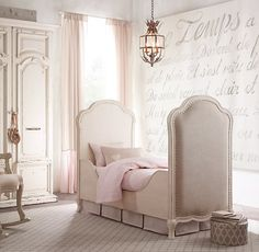 RH Baby & Child's Marceline Upholstered Crib:Marceline offers a more feminine take on the simplicity and restraint of late 18th-century furnishings. We employed arched details and cabriole legs to impart a sense of grace and added soft padded upholstery for lasting comfort.