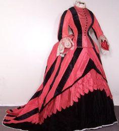 A fabulous original circa 1869 lady's vibrant pink silk taffeta and black silk velvet striped two piece bustled promenade gown. 1870s Fashion, Edwardian Fashion, Vintage Fashion, Steampunk Fashion, Gothic Fashion, Antique Clothing, Historical Clothing, Vintage Gowns, Vintage Outfits