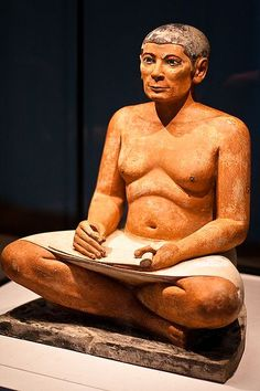 OLD KINGDOM SCULPTURE: The Seated Scribe, from a mastaba tomb at Saqqara. Dynasty V. c. 2500-2400 BCE. Louvre Museum. The most lifelike of Egyptian sculpture. Scribes were of high status but not royal, thus their images could seem less god-like and more human. Click on the link for a good audio description of the sculpture.