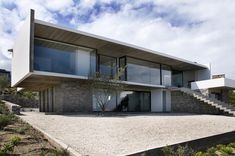 Built by Iván Vial Montero in Zapallar, Chile with date 2007. Images by Rodrigo Opazo. The project is located on a slope overlooking the Pacific ocean towards the west.    The project functions as a cubi...