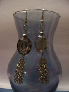 http://www.allfreejewelrymaking.com/Jewelry-Videos/Pretty-Bead-and-Chain-Tassel-Earrings/ct/1