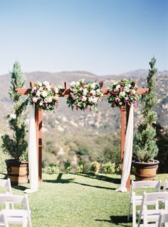 Gorgeous rustic floral display that adorned the scenic archway. Photograph by Kurt Boomer Photo; Venue: Secluded Garden Estate