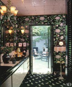 Floral wallpaper sheathes the powder room at Barbara Streisand's elegant Malibu mansion. | archdigest.com