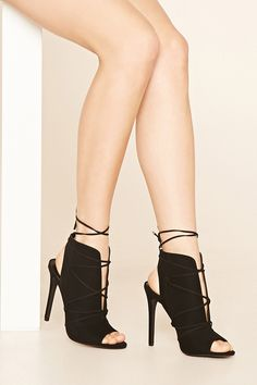 fc554a13d689 A pair of faux suede ankle booties with a split lace-up top