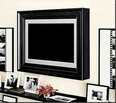 Frame the tv - do this in master bedroom and laundry room too!  http://fullofgreatideas.blogspot.com/2011/03/picture-perfect-tv-flat-screen-tv-frame.html