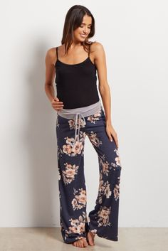 Navy Blue Floral Pajama PAdd some fun to your loungewear with these printed pjs. A drawstring waistband for customized comfort and a pretty floral print to make bedtime a beautiful occasion. Cozy up in these this winter and pair with a basic maternity cami for a good night's sleep. ants