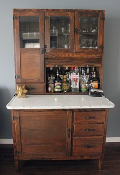 Living in My Living Room Hoosier cabinet. An abomination to turn it into a bar but some people have no taste. An abomination to turn it into a bar but some people have no taste. Cabinet Hoosier, Cabinet Plans, Liquor Cabinet, Alcohol Cabinet, Woodworking Furniture, Woodworking Plans, Woodworking Projects, Workbench Plans, Popular Woodworking