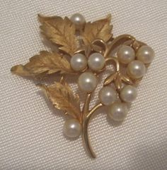Crown Trifari Gold Tone Faux Pearls Leaf Pin Brooch Designer Signed Vintage RARE #CrownTrifari http://www.ebay.com/itm/Crown-Trifari-Gold-Tone-Faux-Pearls-Leaf-Pin-Brooch-Designer-Signed-Vintage-RARE-/181561205395?roken=cUgayN&soutkn=IgGdsM