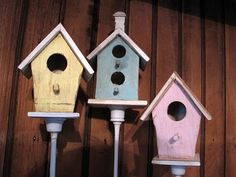 Birdhouses on old candlesticks. I would like some on stakes for the gardens this year.