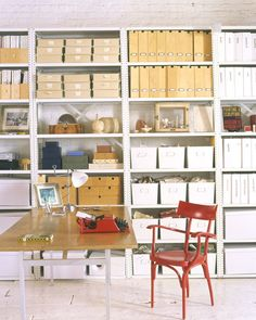 In this home, industrial metal shelves store and organize working materials. To easily keep track, each storage container -– from boxes to bins -– is prominently labeled.