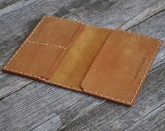 Genuine Leather Passport Holder with Secure Wallet and Personalized Options Travel in style with this handmade leather passport holder. Made of genuine 2 mm leather, this customizable passport holder is both durable and trendy. Store anywhere from four to six credit cards and banknotes on one side of the leather holder, and one to two passports on the other side. Your important personal documents and cards are sure to be secure in this double passport holder and wallet. Not only is the…