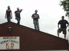 Rescue U student volunteers work on roof repairs of the Morehead County Animal Shelter.