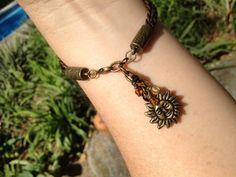 Leather Wrap Bracelet with Charm, Metallic Kansa (Bronze) Leather and Bronze Sun Charm (LB-379). $35.00, via Etsy.