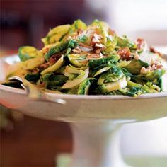 Brussels Sprouts with Pecans by cookinglight: These take just a brief turn in the pan--slicing the sprouts cuts down on their cooking time. The dish's sweet, buttery flavors mellow the bite of the Brussels sprouts. #Brussel_Sprouts #Quick